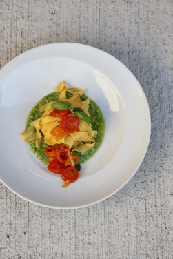 fesh tagliatelle with cherry tomatoes and pesto.